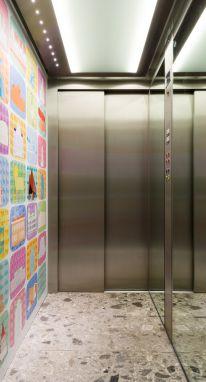 Personaliseer uw liftwand met een eigen print
